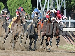 Tonalist and Kid Cruz run with Wicked Strong in the Jim Dandy Stakes.