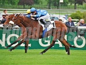 Flotilla wins the Poule d'Essai des Pouliches at Longchamp in France.