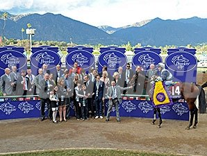 Karakontie and connections in the winner's circle after the 2014 Breeders' Cup Mile.