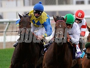 Smart Bid (green cap) wins the 2012 Fair Grounds Handicap.