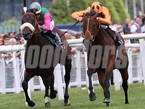 Canford Cliffs, right, wins the Lockinge Stakes,