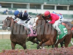 Karelian (right) and Demarcation head to a dead-heat in the River City Handicap.