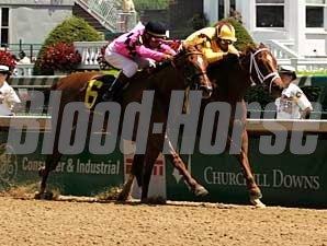 Game Face (inside) holds off a determined Keep the Peace in the La Troienne Stakes (gr. III).