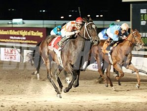 Productive Envoy wins the 2009 Louisiana Legacy.