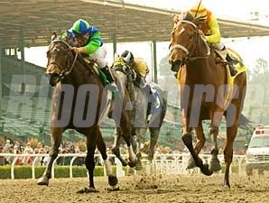 Tiz Elemental (right) wins the Las Flores Handicap (gr. III) April 6 at Santa Anita, her fourth consecutive victory.