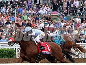 Goldencents wins the 2014 Breeders Cup Dirt Mile.