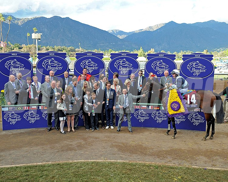 Karakontie, with Stephane Pasquier, and his connections in the winner's circle following the Breeders' Cup Mile (gr. I).