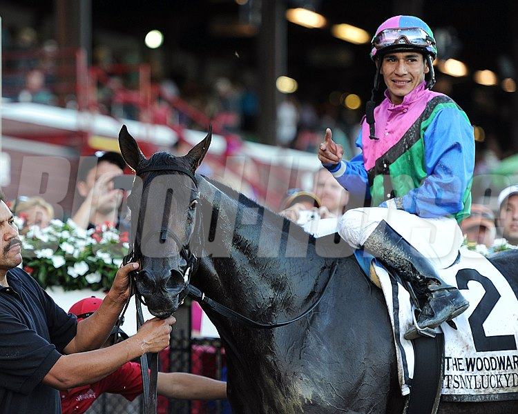 Itsmyluckyday and jockey Paco Lopez wins the Grade I Woodward Stakes at Saratoga Race Course on August 30, 2014. 