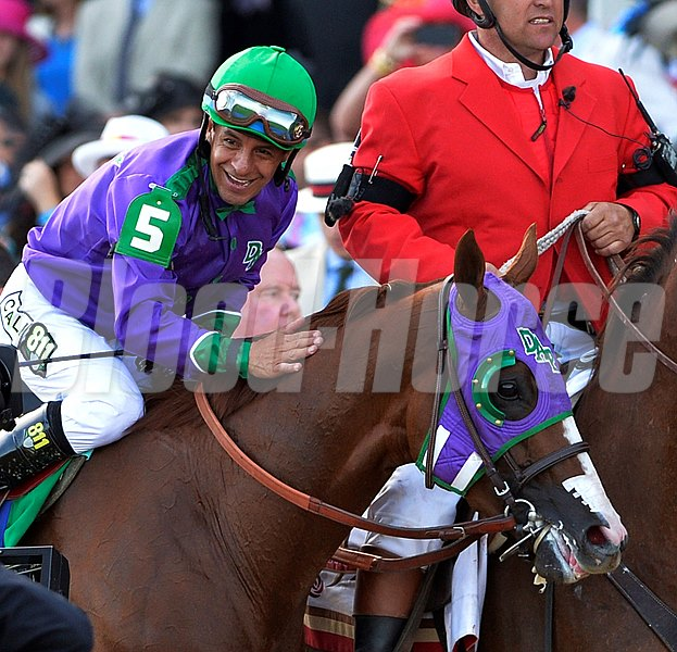 Victor Espinoza gives California Chrome a pat on the neck after winning the 2014 Kentucky Derby.