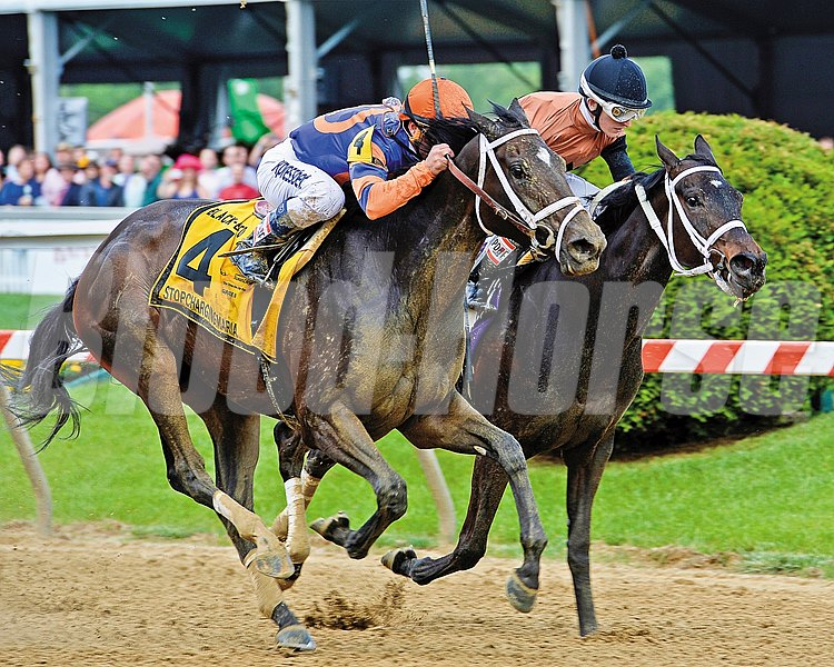 Stopchargingmaria (left) gets by Vero Amore to win the Black-Eyed Susan Stakes at Pimlico Race Course.