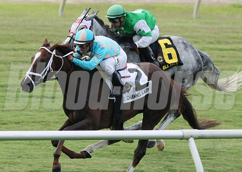 Channel Lady and jockey Javier Castellano wins The 15th Running of the Edward P. Evans All Along Stakes at Colonial Downs in New Kent, Virginia.