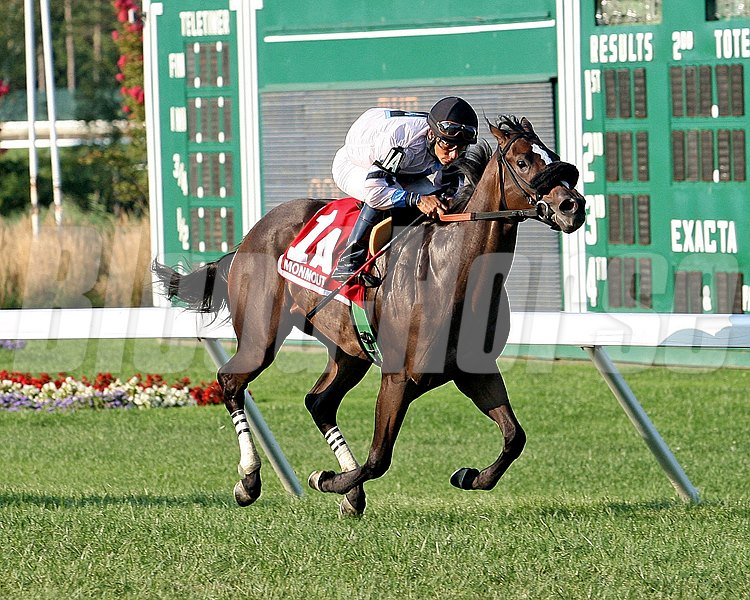 Flay Mignon and jockey Paco Lopez capture the Colleen Stakes at Monmouth Park.