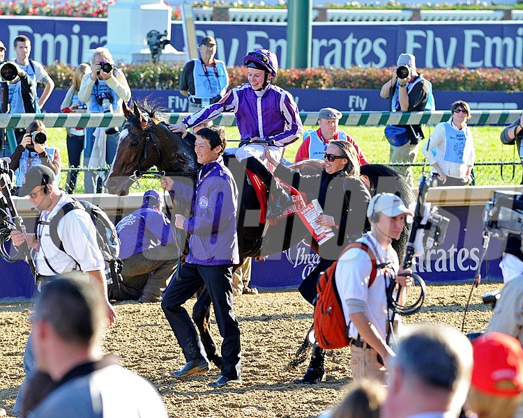 Jockey O'Brien is congratulated by his mother Anne Marie O'Brien after St Nicholas Abbey wins the Emirates Airlines Breeders' Cup Turf.