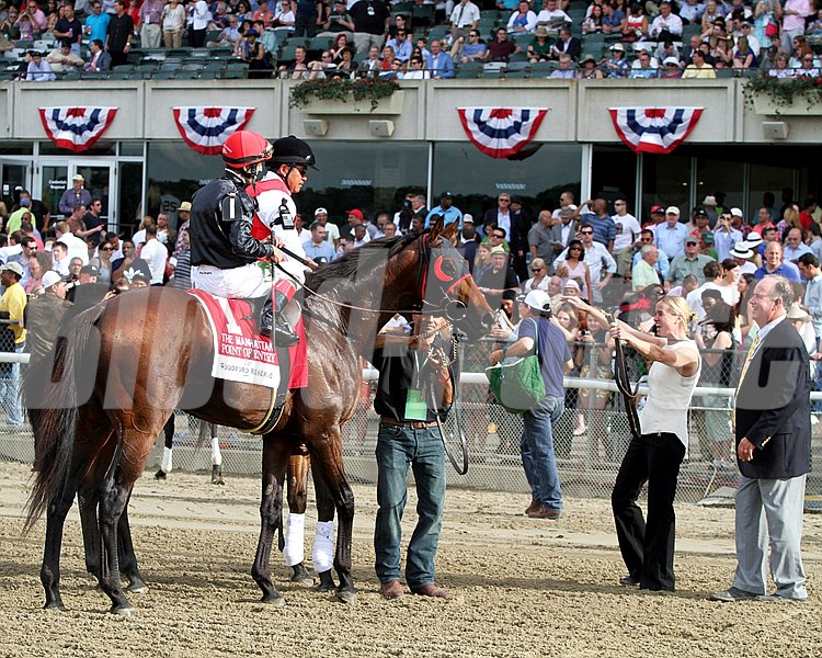 Jenn Patterson greets Point of Entry w/John Velazquez up after winning The 112th Running of The Manhattan at Belmont Park on June 8, 2013. Photo By: Chad B. Harmon