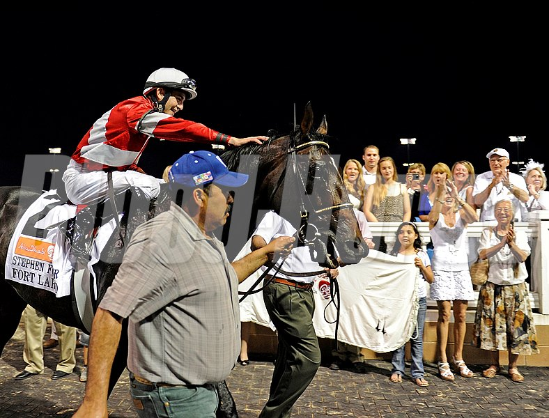 Fort Larned with Brian Hernandez Jr. up celebrate after winning the Stephen Foster Handicap (gr. I) at Churchill Downs.