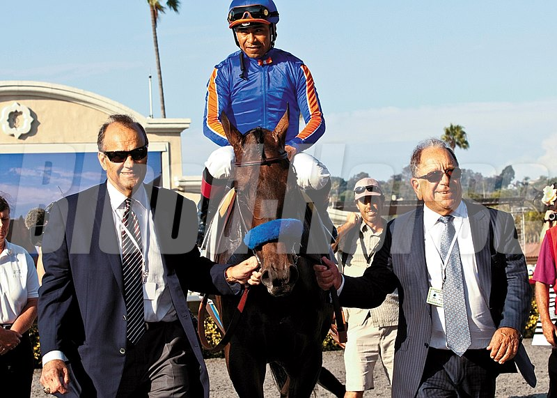 Co-owners Joe Torre (left) and Bernie Schiappa (right) escort favored Game On Dude and Martin Garcia into the winner's circle after victory in the Grade I $1,000,000 Pacific Classic at Del Mar in 2013.