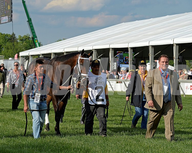 General a Rod and his connections walking to the paddock.