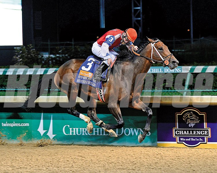 Moonshine Mullin and jockey Calvin Borel are victorious in the Grade I Stephen Foster Handicap at Churchill Downs on June 14, 2014.