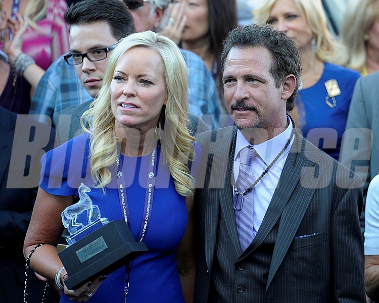 Mizdirection owner Jim Rome, right, wins the Breeders' Cup Turf Sprint at Santa Anita.