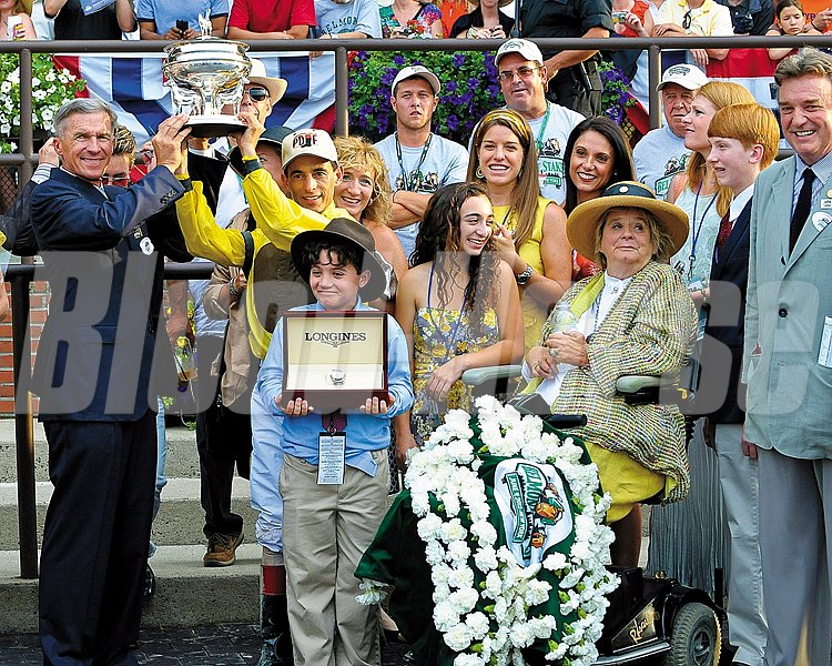 Caption: Trophy Pres: Michael Matz, John Velasques, Phyllis Wyeth Union Rags with John Velazquez wins the Belmont Stakes (gr. I). Belmont Park, June 9, 2012, Elmont, N.Y. Anne M. Eberhardt photo