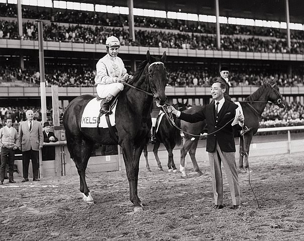Kelso is held by Eddie Arcaro at New York's Aqueduct on November 5 during celebration of Old Timers' Day. In the saddle is Ismael Valenzuela.