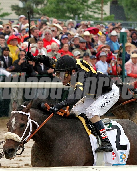 Gary Stevens goes to work on Oxbow in the stretch of the 139th Kentucky Derby at Churchill Downs on May 4, 2013.