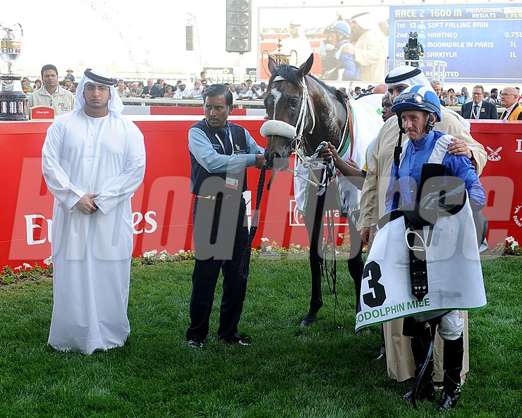 Soft Falling Rain in the winner's circle after a victory in the Godolphin Mile.