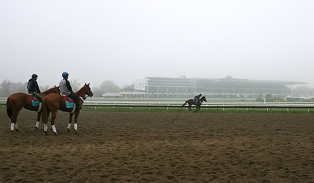 Horses and riders workout in the fog on Tuesday morning May 7, 2013 at Monmouth Park Racetrack in Oceanport, N.J. The racing season kicks off on the Jersey Shore this Saturday May 11th as Monmouth Park celebrates it's 68th season of thoroughbred racing.