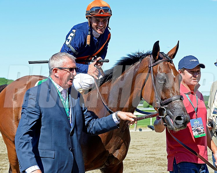 Trainer Brian Lynch, left, walks in with horse. Coffee Clique with Javier Castellano wins the Longines Just a Game (gr. I)