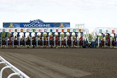 Queen's Plate starters break from the starting gate in the 152 running of the Queen's Plate at Woodbine Racetrack.