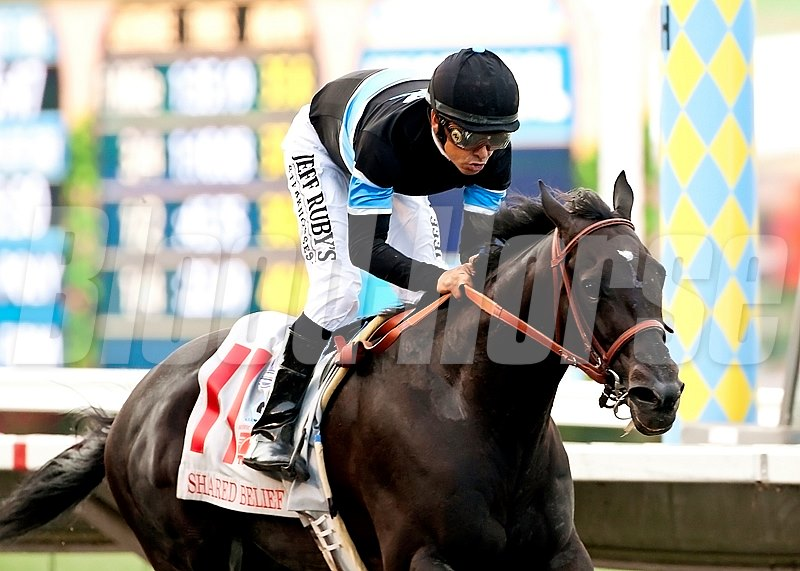 Shared Belief and jockey Mike Smith are triumphant in the TVG Pacific Classic.
