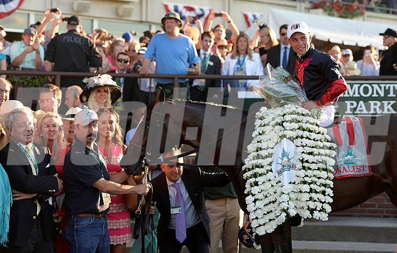 The garland of Carnations adorns Tonalist in the Belmont Stakes Winner's Circle.