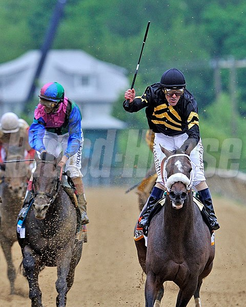 Gary Stevens celebrates winning the 138th Preakness on Oxbow...