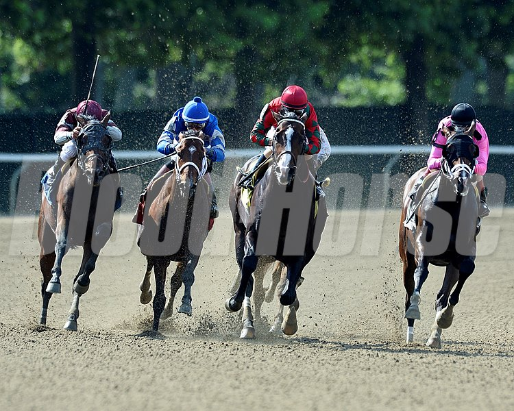 Flat Out and jockey Junior Alvarado pull ahead to  win the Suburban Handicap at Belmont Park in Elmont, NY.