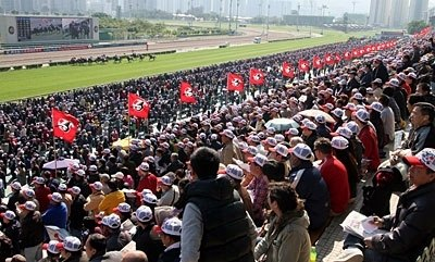 The packed grandstands of the Sha Tin Racecourse on the Cathay Pacific Hong Kong International Races Day.
