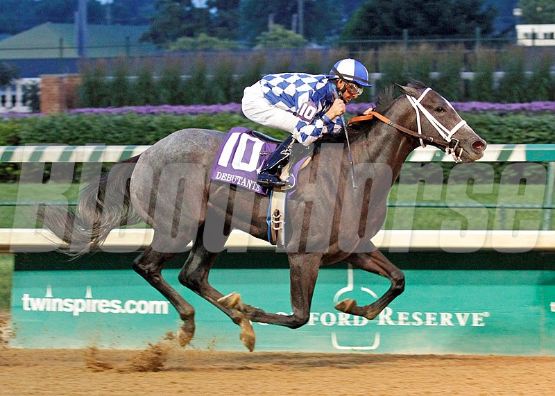 "Fiftyshadesofgold won the 113th running of the $113,400 Debutante Stakes by eight lengths under Corey Lanerie at ""Downs After Dark"" at Churchill Downs."
