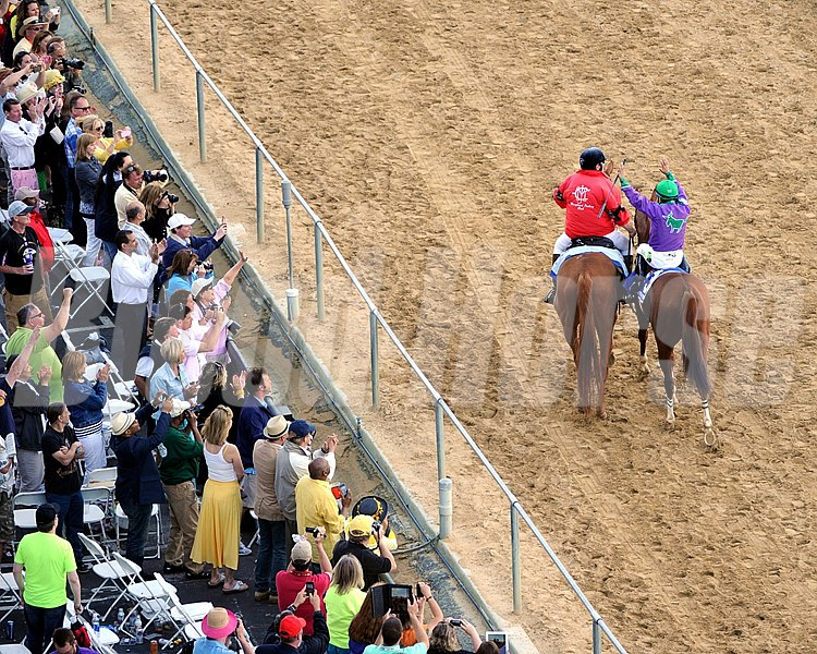 Victor Espinoza celebrates with the fans aboard California Chrome after winning the Preakness at Pimlico on May 17, 2014.