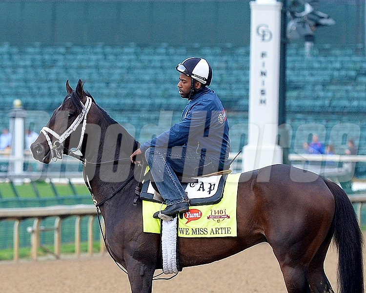 Caption: WE Miss Artie in front of finish line post