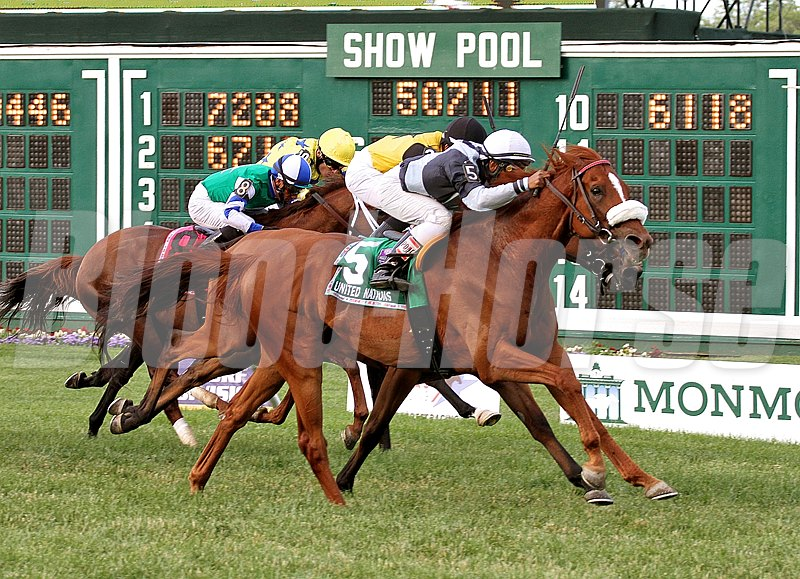 Main Sequence #5 with Rajiv Maragh riding (left) held off the challenge of #3 Twilight Eclipse and Jose Lezcano to win the $500,000 Grade 1 United Nations at Monmouth Park.