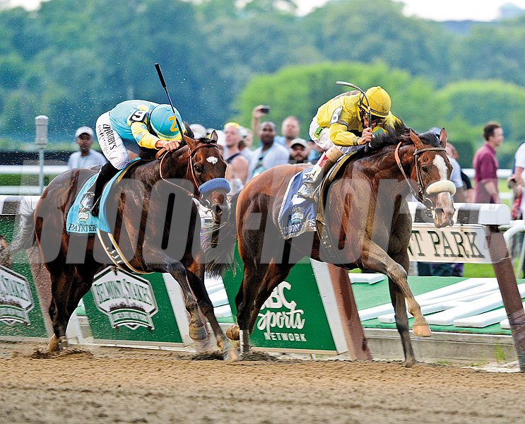 Union Rags comes up the rail, right with jockey John Velazquez to beat Paynter with Mike Smith to win the 144th running of The Belmont Stakes at Belmont Park in Elmont, N.Y. June 9, 2012.  (Skip Dickstein