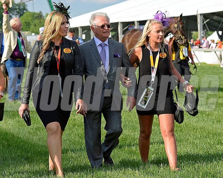 California Chrome trainer Art Sherman and two lovely girls walking to the  paddock prior to the Preakness Stakes.