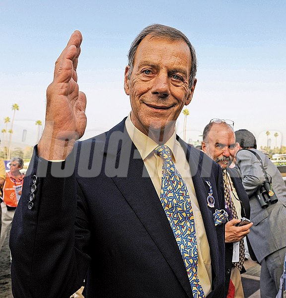 Trainer Sir Henry Cecil salutes. Midday with Thomas Queally wins the Emirates Airline Breeders' Cup Filly and Mare Turf in 2009.