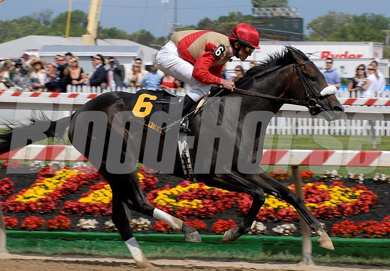 CAPTION: Chelokee wins the Barbaro Stakes