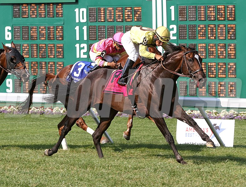 Guys Reward #8 and jockey Paco Lopez are rewarded in the $150,000 Metopolitan Jets Oceanport Stakes at Monmouth Park in Oceanport, New Jersey.