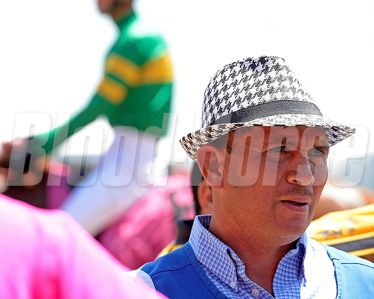 Caption:  even the grooms go for the fashion on Preakness weekend