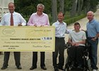 Castleton Lyons Presents Check to PDJF