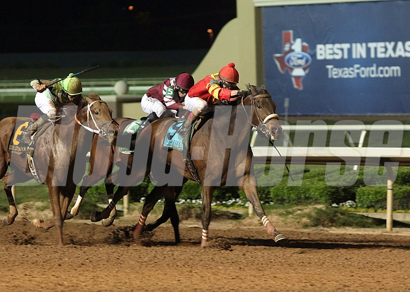 Paul Rigali Jr.'s homebred Texas Air put away a field almost entirely composed of out-of-state invaders to claim the $200,000 Grade III Texas Mile under the lights at Lone Star Park.