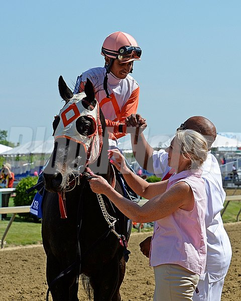 Caption:  Ben's Cat with Julian Pimentel wins the Jim McKay Turf Sprint. King Leatherbury owner/trainer.