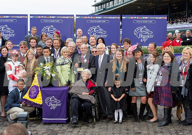 Stepahnie's Kitten connections celebrate in the winner's circle.