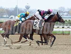 Kid Cruz fights off Madefromlucky to win the Excelsior Stakes.